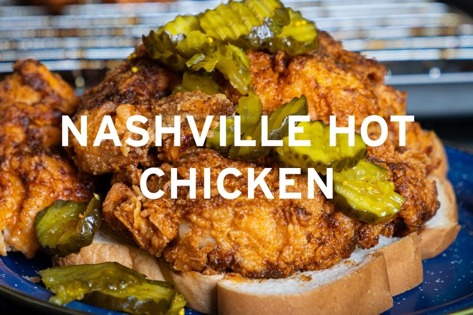 fried chicken on a thick sliced piece of bread with pickles on a blue plate centralized text reading