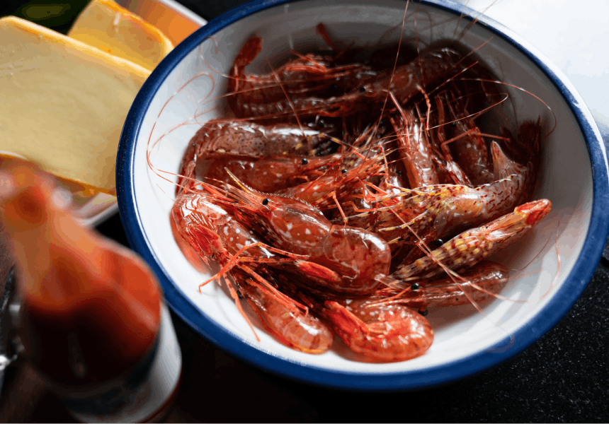 prawns in a blue rimmed bowl