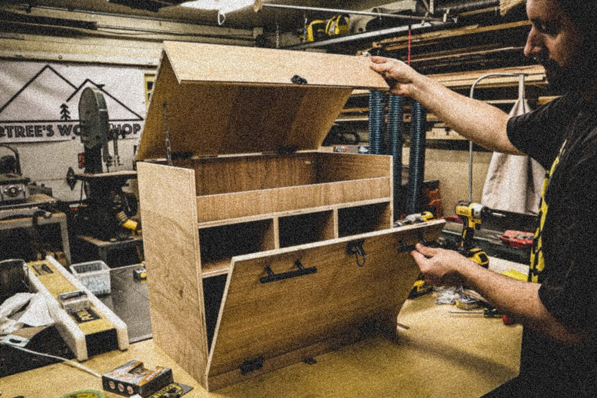 wooden camp cooking supply box being built and demonstrated in a wood working shop