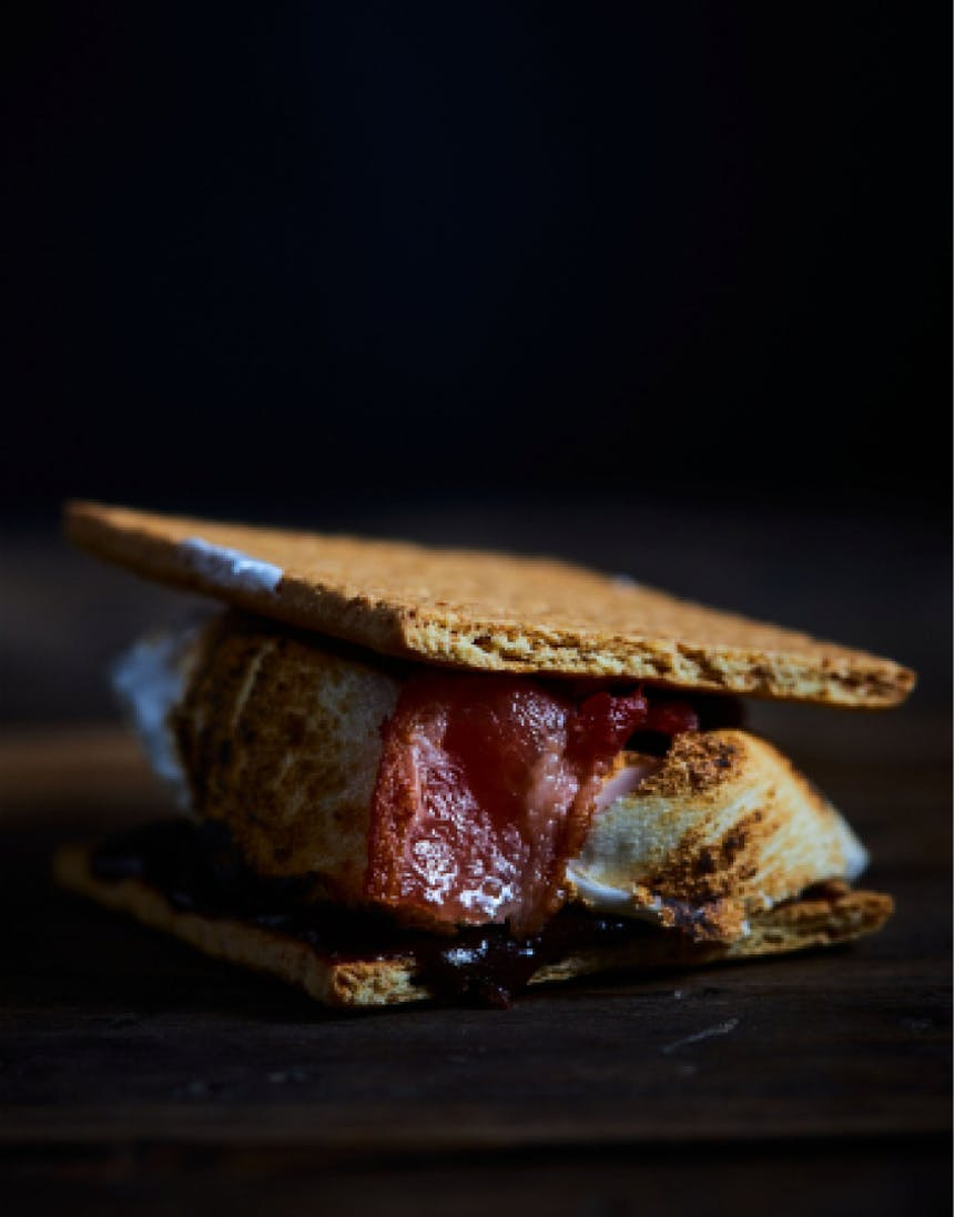 graham crackers with roasted marshmallow, chocolate, and bacon in between