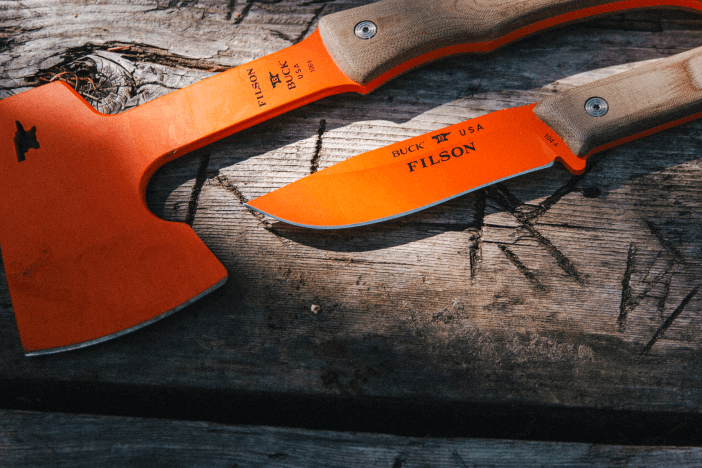 orange bladed filson knife and hatchet