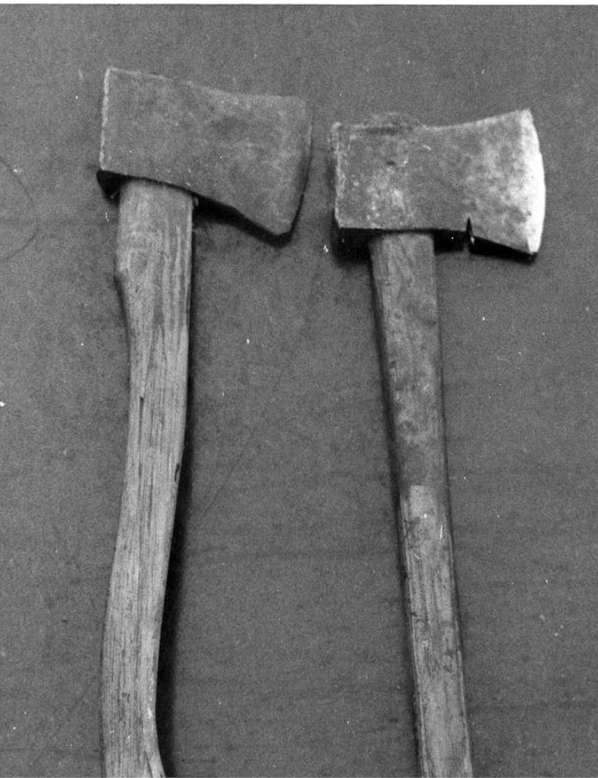 two axes with wooden handles