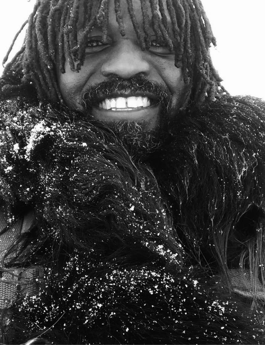 ray livingston smiling wearing snow dusted fur