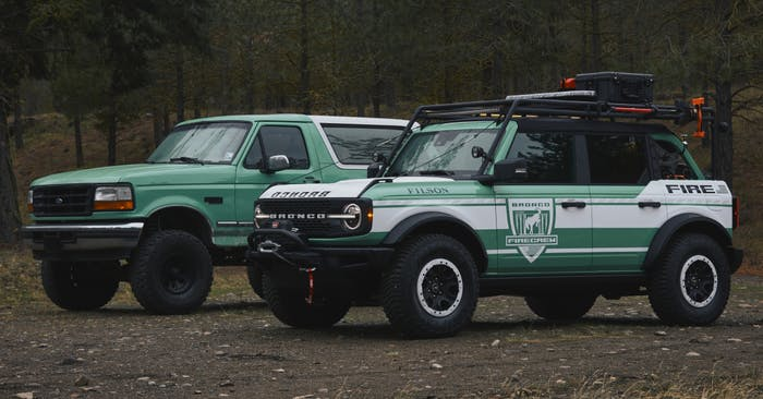vintage and new ford broncos parked in a field
