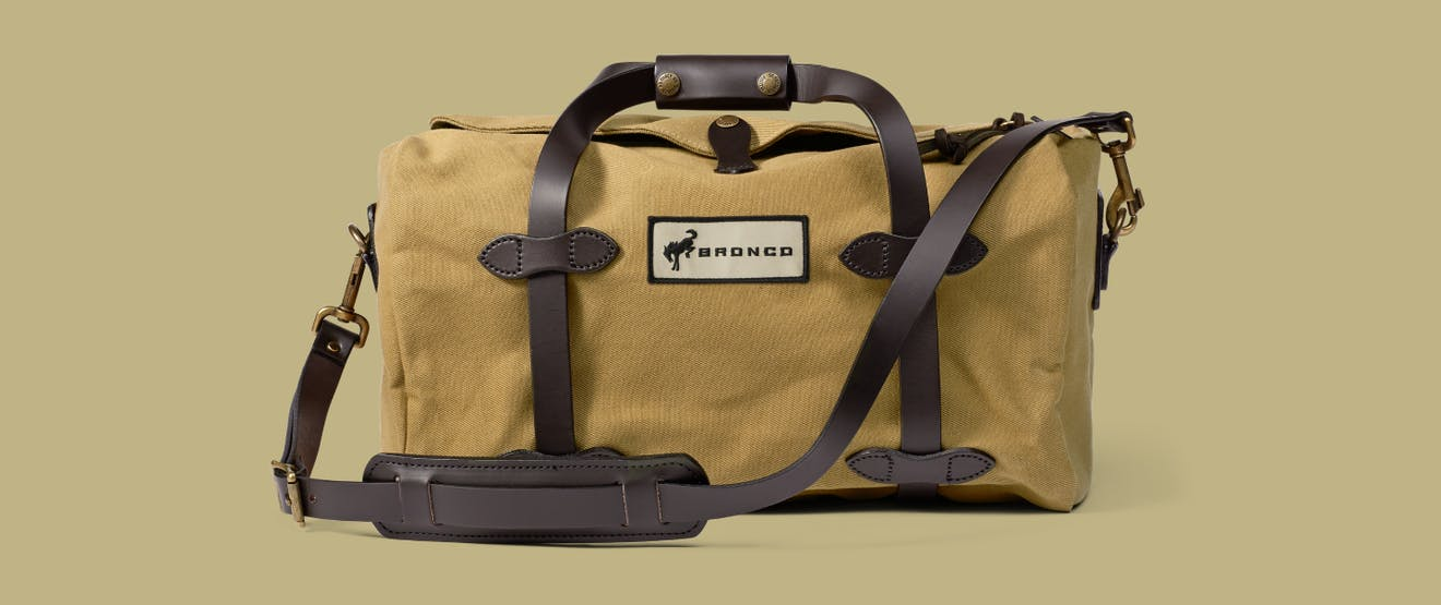 tan filson duffel with leather straps and
