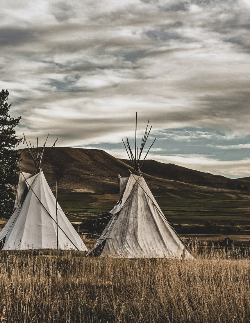 painting of teepees in a grassy field
