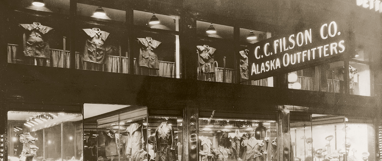 vintage black and white image of C.C. Filson Co. Alaska Outfitters storefront