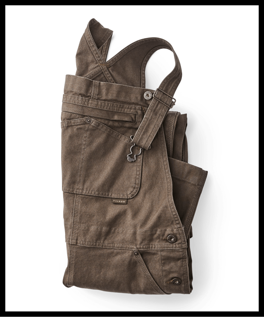 folded brown filson overalls