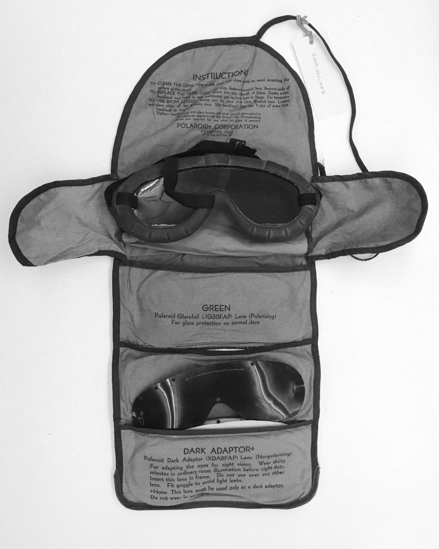 vintage pack containing glacier goggles and instructions for safe use with spare black lens