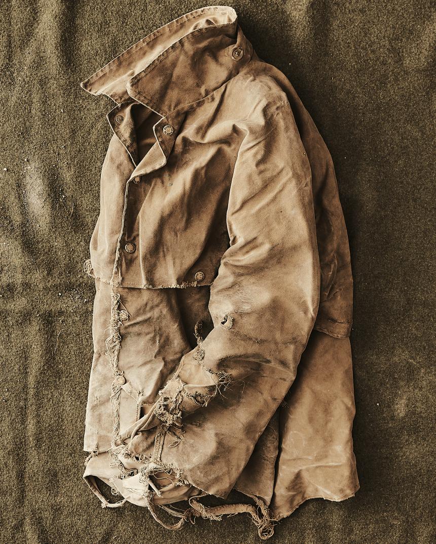 worn Tan Tin cloth cruiser folded set on ground