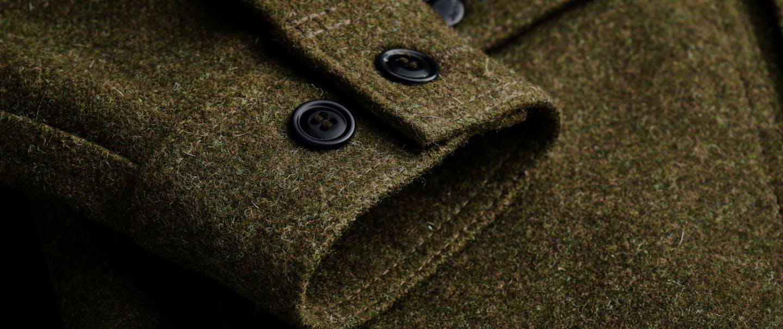 close-up of cuff of mackinaw wool olive colored jacket cuff