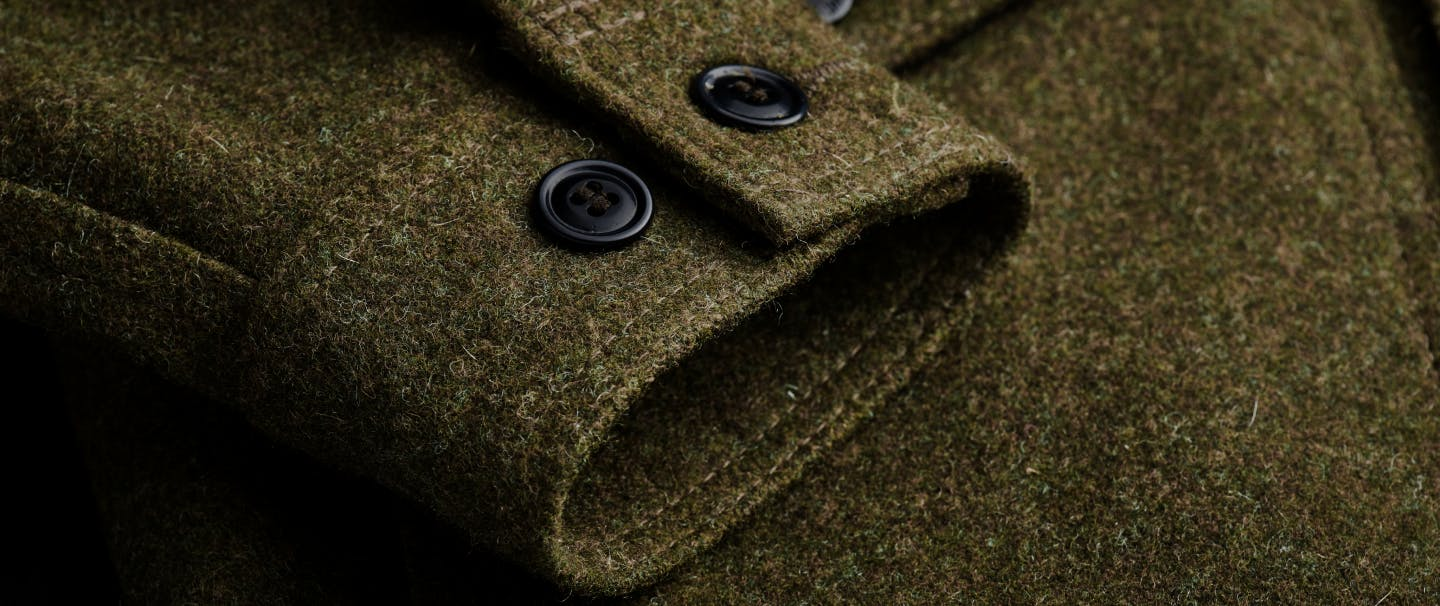 close-up of cuff of mackinaw wool olive colored jacket cuff