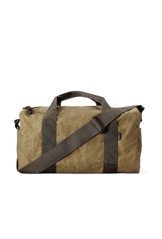 Tin cloth duffel style bag with brown handle straps and shoulder strap