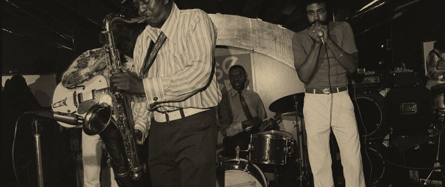 black and white image of men playing in Band