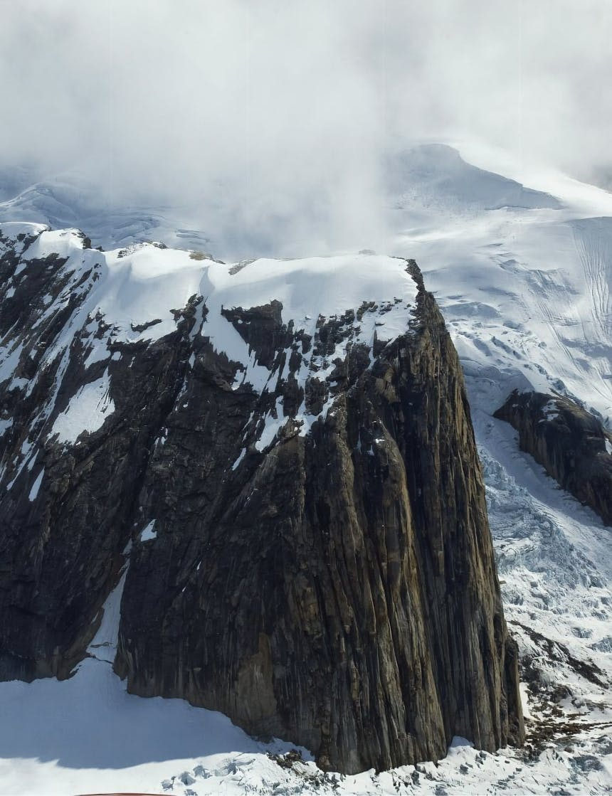snow capped sheer rock face on approach to denali