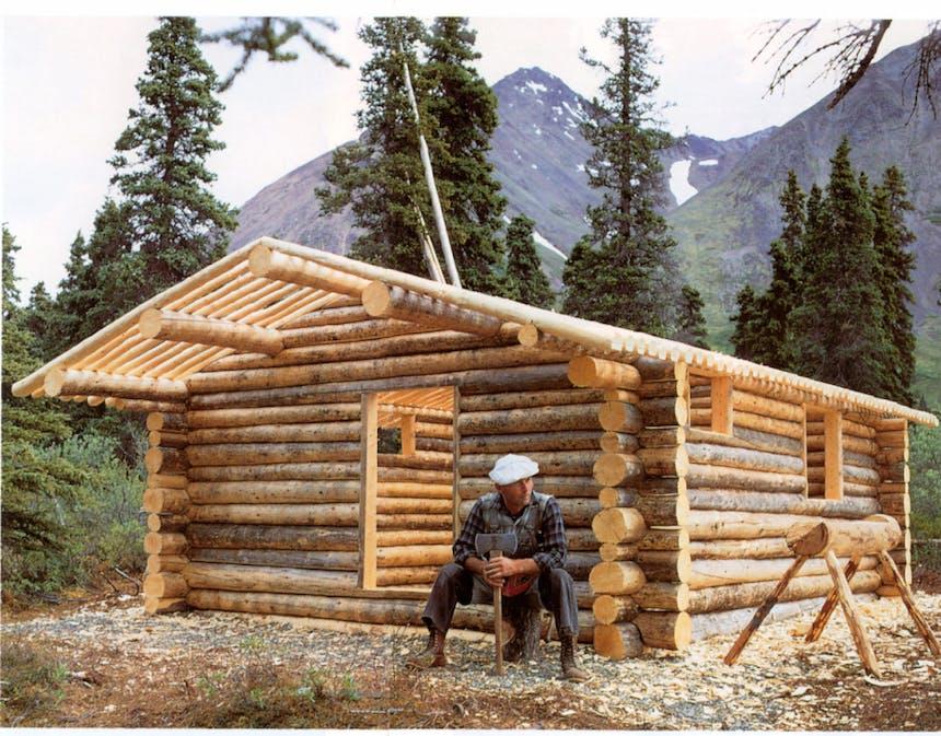Richard Proenneke building his cabin in the Alaskan Forest
