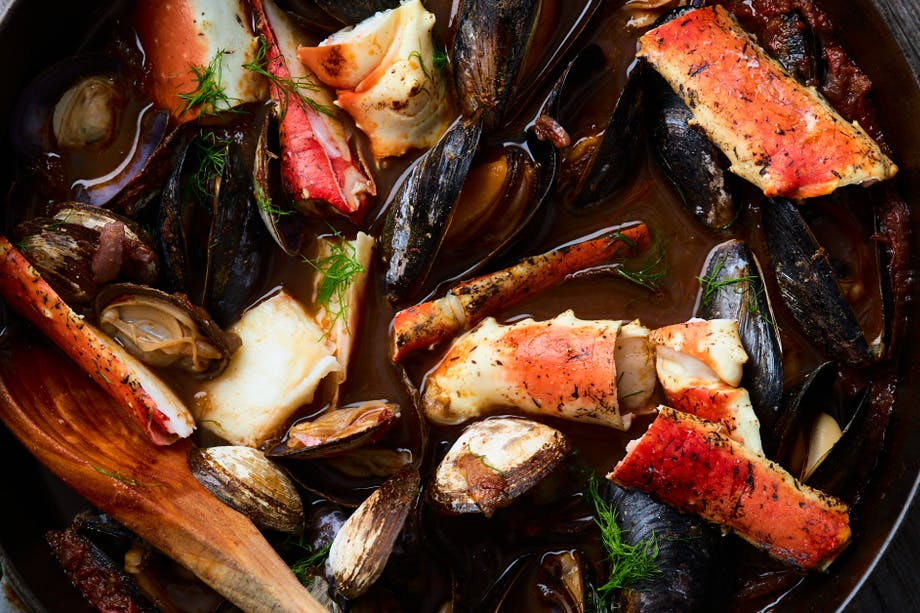 cooked seafood stew with mussels, white fish, clams, and crab