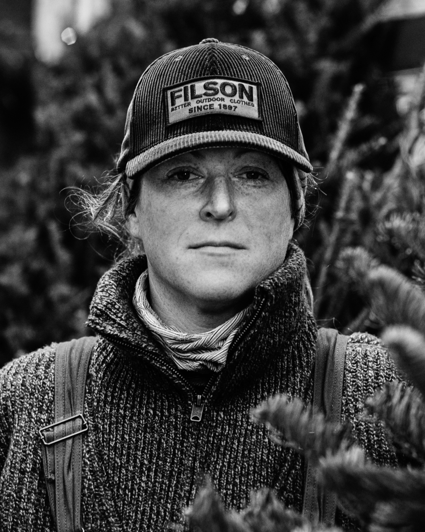 black and white portrait of emily mullen in a filson hat