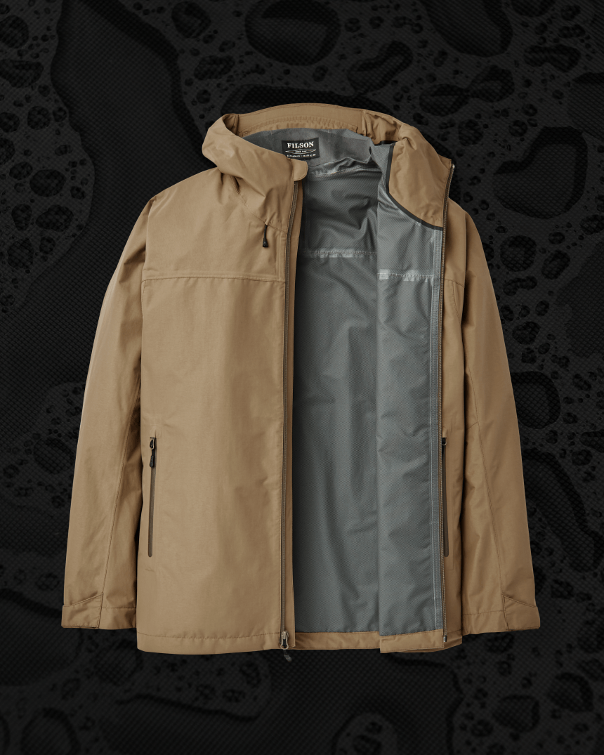 brown lightweight active rain shell partially unzipped to show interior