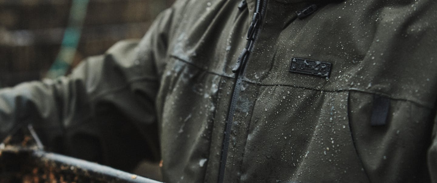 olive filson waterproof coat with water beading on it