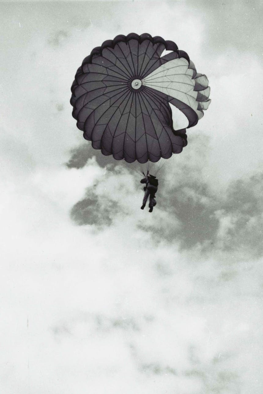 person hanging from a parachute