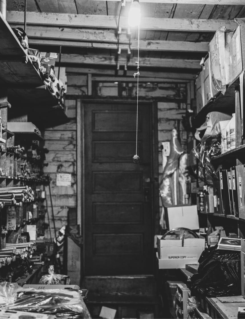 black and white image of the back store room at anacortes junk co