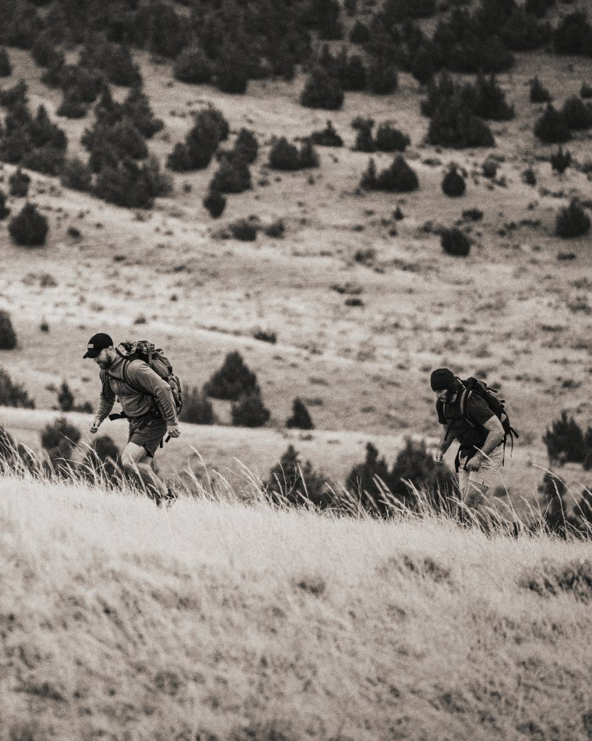 Two men rucking in the Montana wilderness.