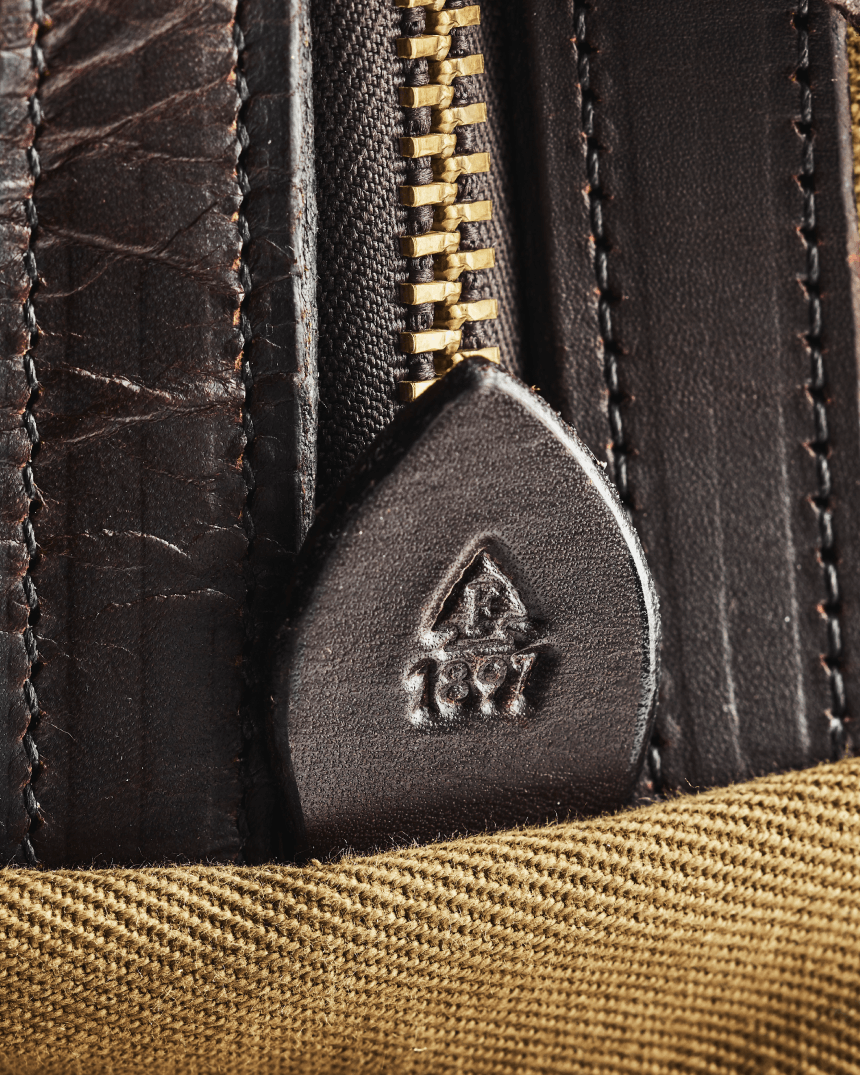 Close up of Filson Rugged Twill bag, showing detail of fabric and Bridle Leather.