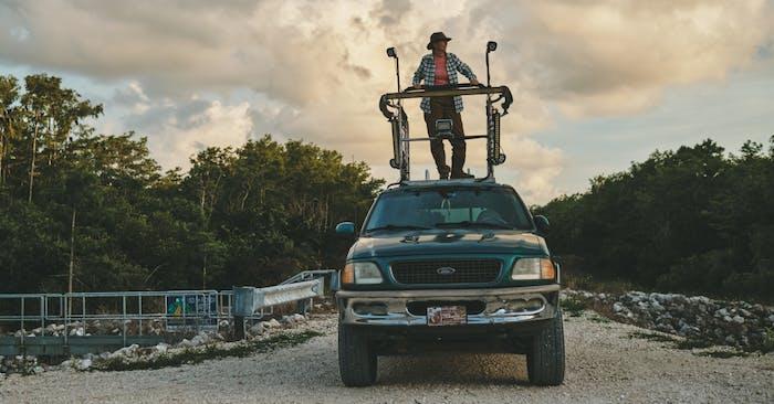Donna Kalil standing on top of her SUV's hunting platform.