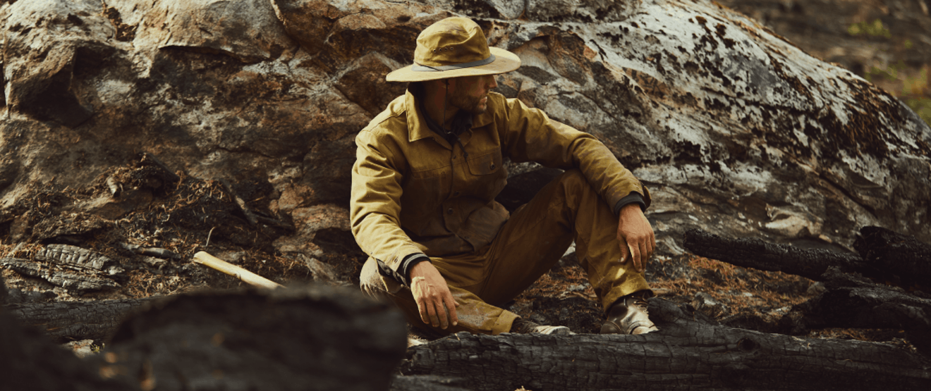 Man wearing Filson Tin Cloth jacket, pants, and hat.