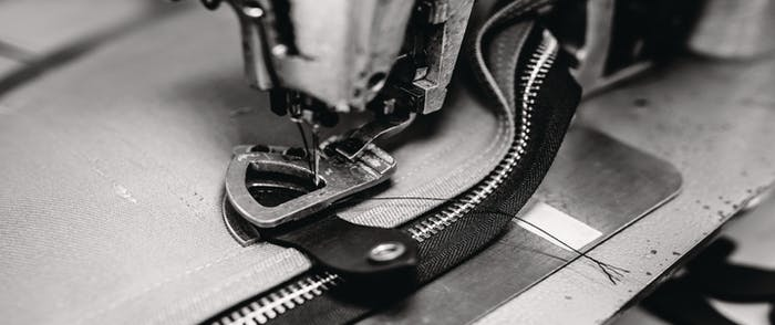 Close-up of a sewing machine in the Seattle Filson factory.