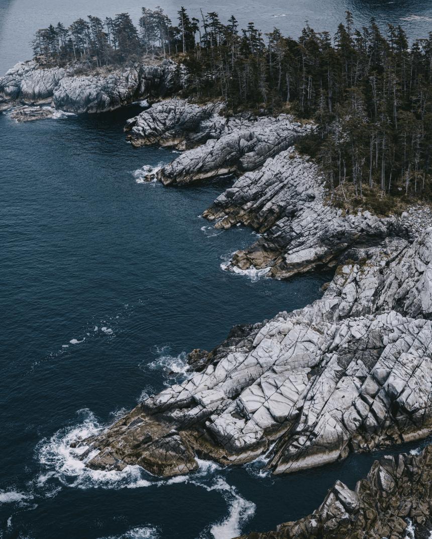 AAerial photograph of the ocean and coastline in Alaska.