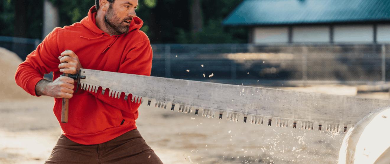 Logger wearing long-sleeve Filson shirt.