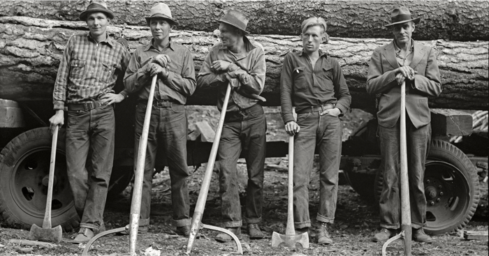 Black and white historical photo of five men wearing White's Boots.