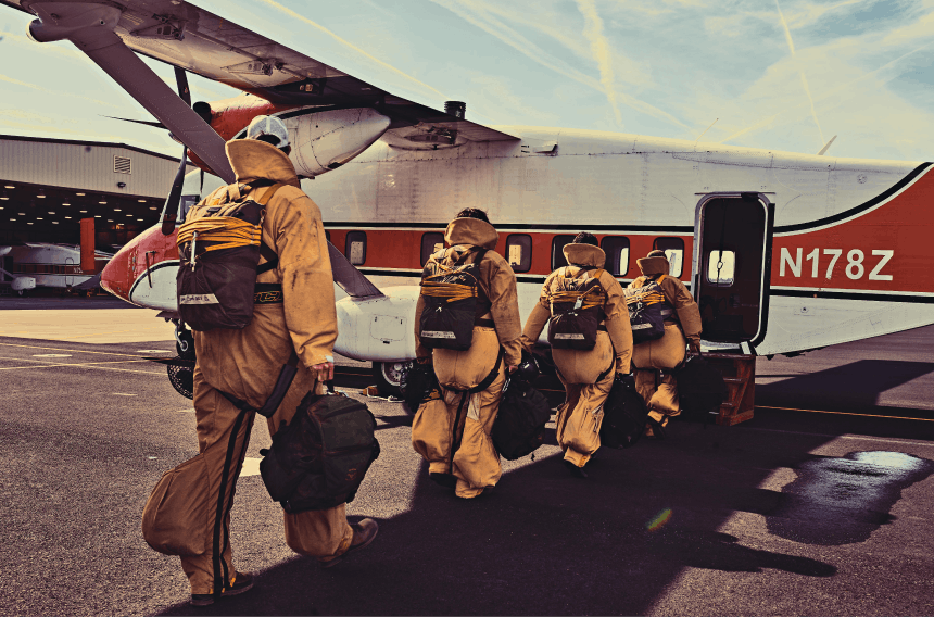 U.S. Forest Service smokejumpers boarding aircraft.