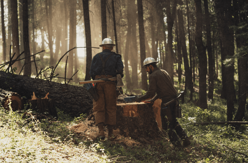 Two modern day loggers wearing Filson x White's Boots.