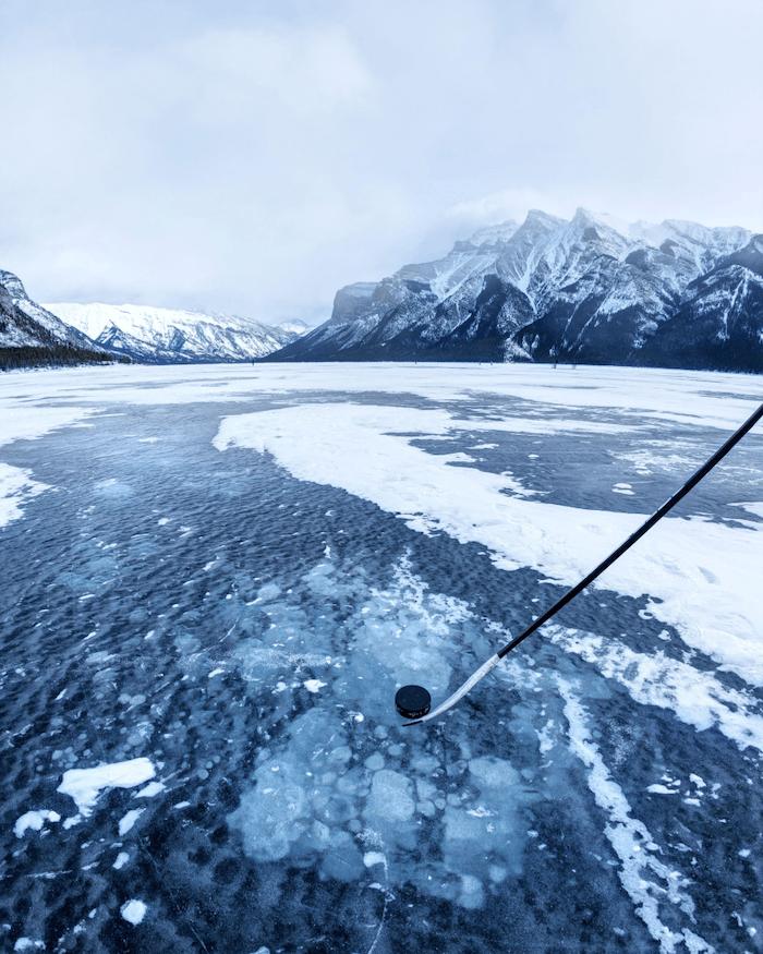Ice hockey puck on frozen lake