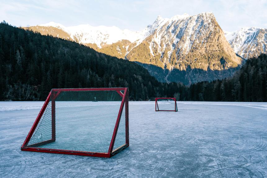 Pond hockey setup on alpine lake
