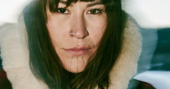 Close up portrait of Deenaalee wearing Filson
