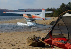 A Cessna and Filson duffle in camp
