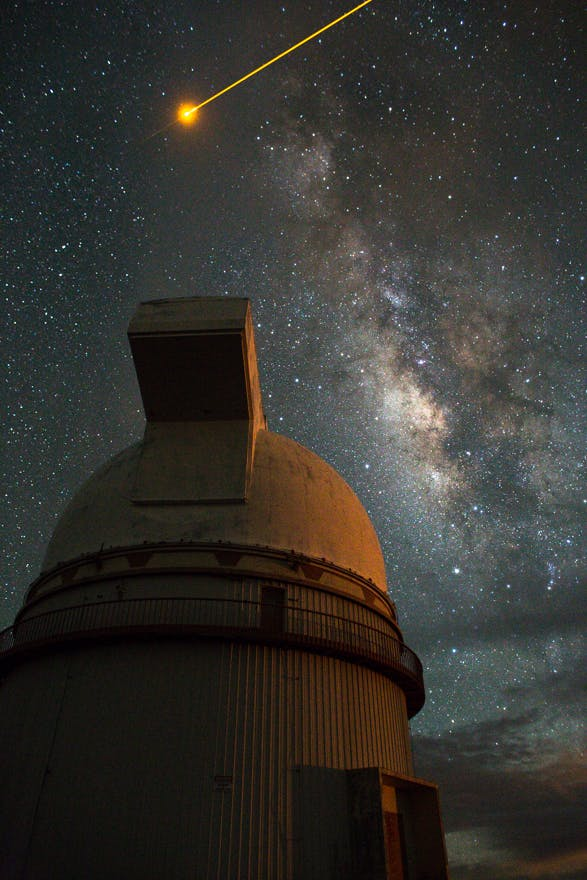 Milky Way: Mauna Kea Observatory. w/ laser from Observatory. Big Island, Hawaii