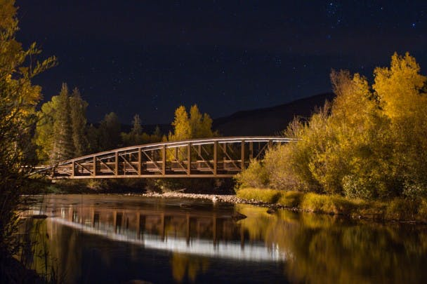 Jamieson Memorial Bridge. Autumn night on the Blue River: Silverthorne, Colorado.