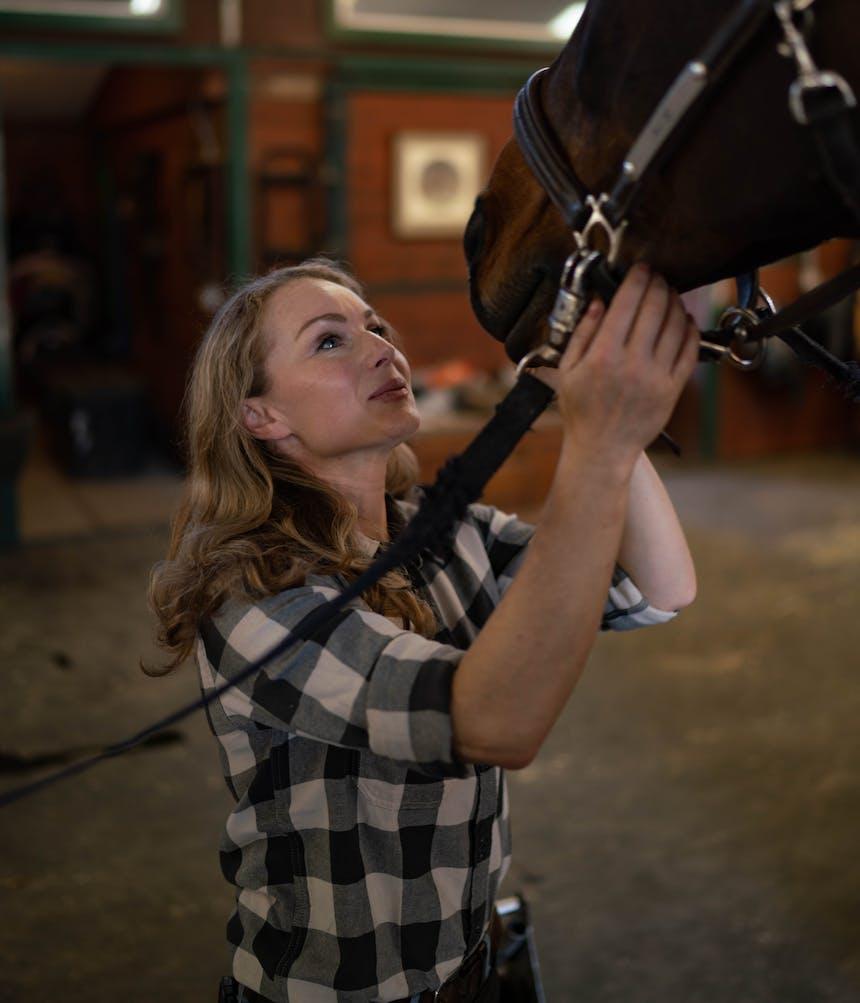 woman petiting horse