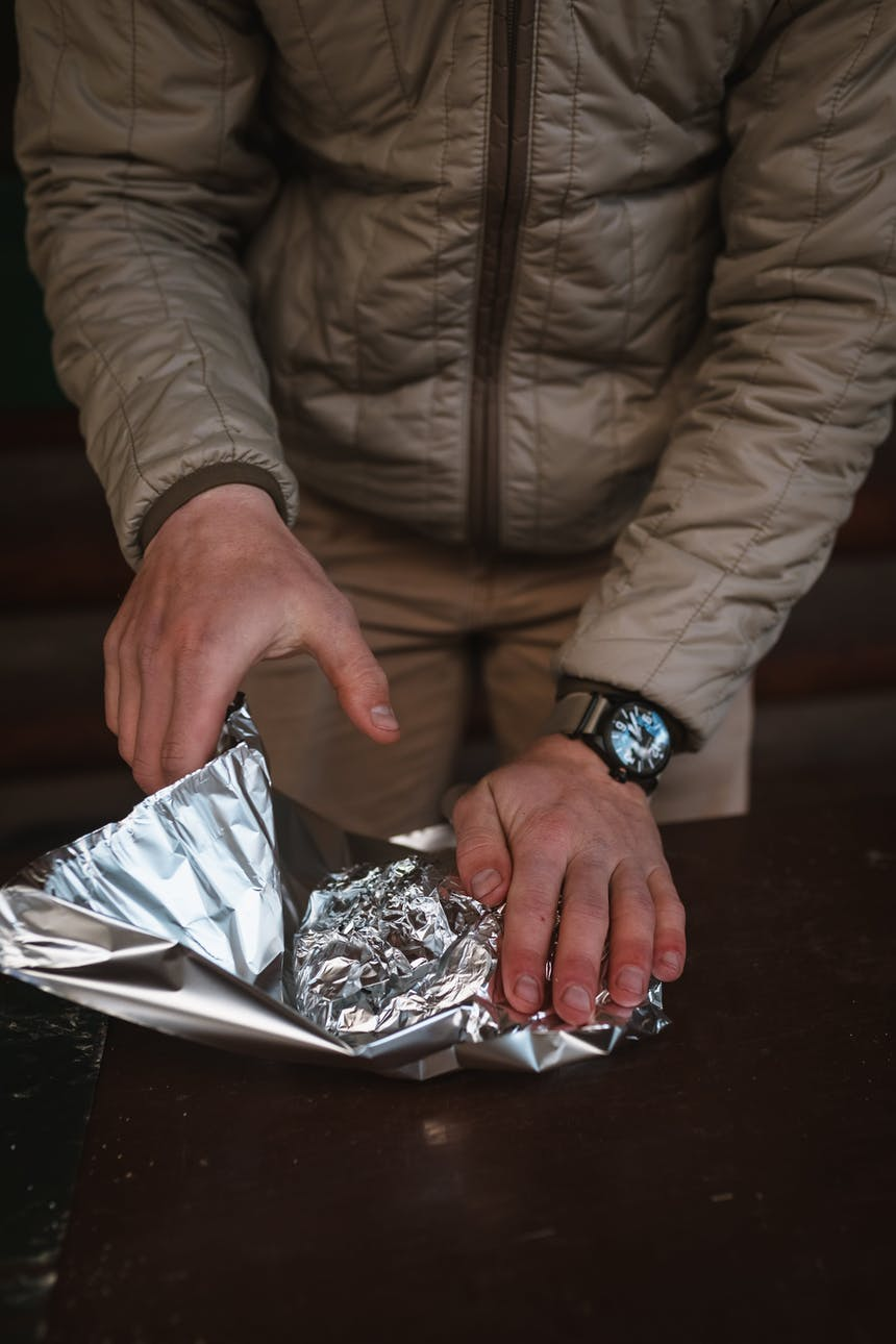 tightly wrapping tin foil meal