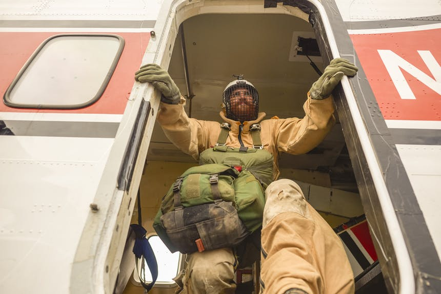 Smokejumper jumping out of plane