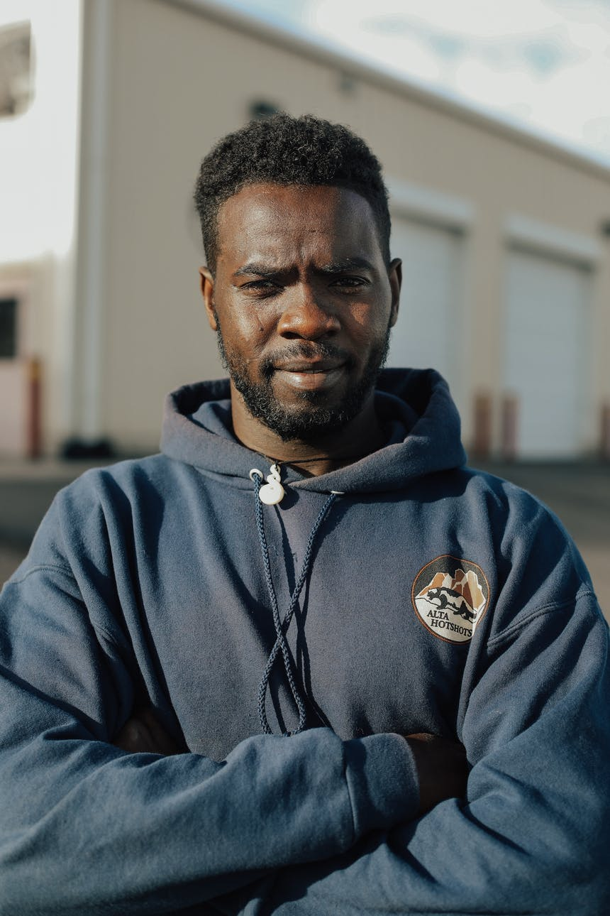 hotshot crew member portrait of man in blue sweat shirt