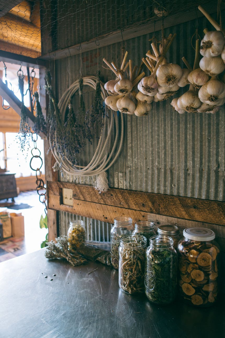herbs drying, hanging on wall and in jars