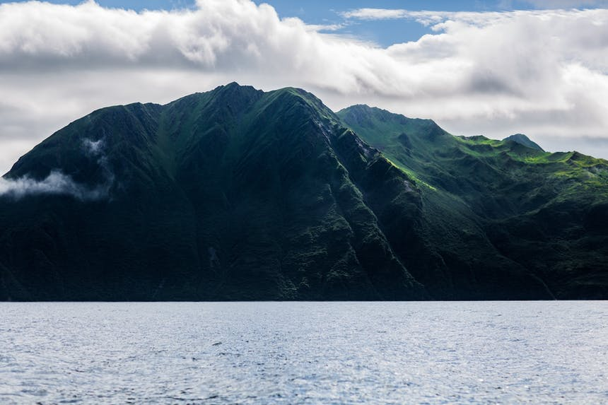 Kodiak coastline with tall green mountains and body of water