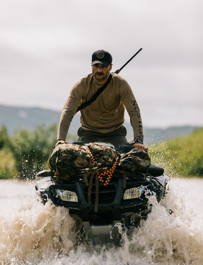 brett watts on ATV in water