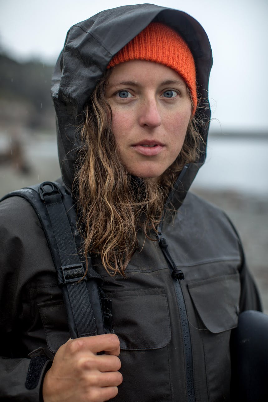 claire portrait in black raincoat with orange hat